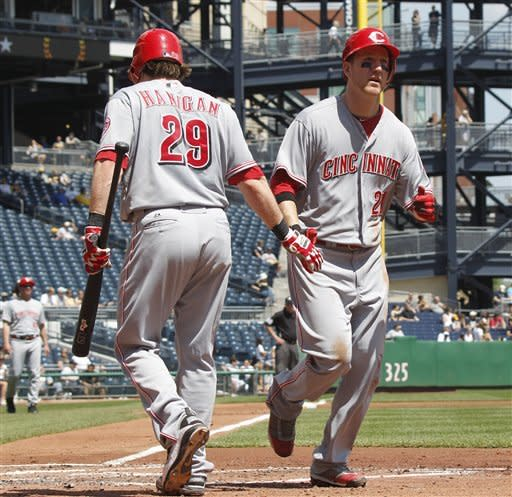 Cincinnati Reds' Todd Frazier (21) is greeted by on deck-batter Ryan Hanigan after hitting a solo home run in the second inning of a baseball game against the Pittsburgh Pirates on Sunday, May 6, 2012, in Pittsburgh. (AP Photo/Keith Srakocic)