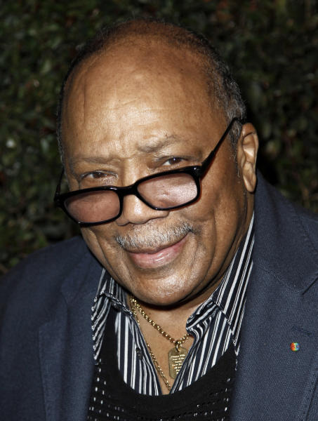 """FILE - Quincy Jones arrives at the world premiere of the music video for Paul McCartney's song, """"My Valentine"""", in West Hollywood, Calif., in this April 13, 2012 file photo. Jones sued Jackson's estate on Friday, Oct. 25, 2013, claiming that he was owed millions in royalties and fees on music that's been used in post-death Jackson projects including the """"This Is It"""" concert film. Jones produced Jackson's """"Off the Wall,"""" """"Thriller"""" and """"Bad"""" albums. (AP Photo/Matt Sayles, File)"""