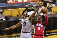 Mississippi's Matthew Murrell, right, shoots past Missouri's Mark Smith during the first half of an NCAA college basketball game Tuesday, Feb. 23, 2021, in Columbia, Mo. (AP Photo/L.G. Patterson)
