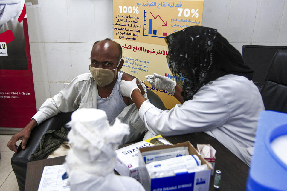 A medical worker receives a dose of the Oxford-AstraZeneca COVID-19 coronavirus vaccine at the Jabra Hospital for Emergency and Injuries in Sudan's capital Khartoum on March 9, 2021. - Sudan is the first in the Middle East and North Africa to receive vaccines through COVAX, a UN-led initiative that provides jabs to poor countries, according to children's agency UNICEF. The first batch to arrive was comprised of 828,000 doses of the AstraZeneca vaccine, which are planned to cover 414,000 frontline health care workers across the country, according to health officials. (Photo by Ebrahim HAMID / AFP) (Photo by EBRAHIM HAMID/AFP via Getty Images)