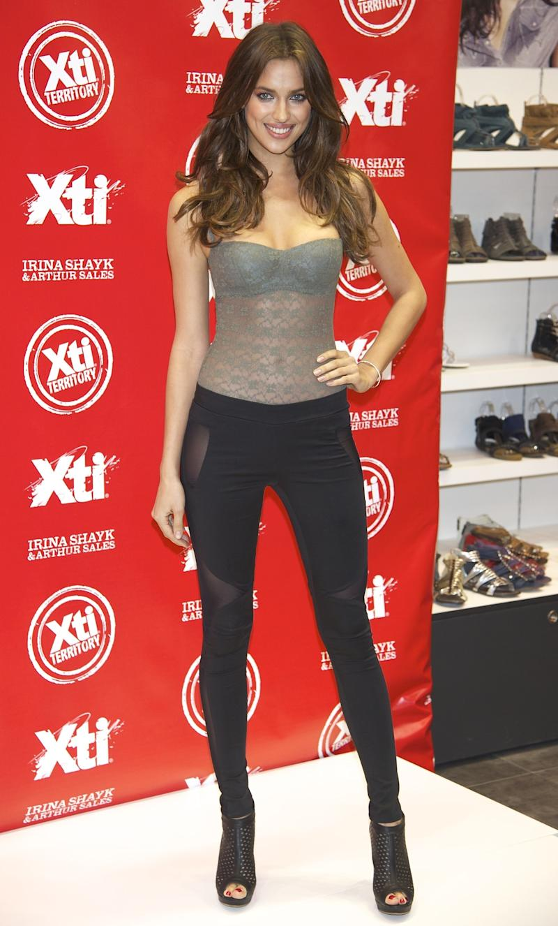 Shayk kept it on the casual side in stretchy pants, a lace tube-top, and peep-toe booties for a 2011 in-store appearance.