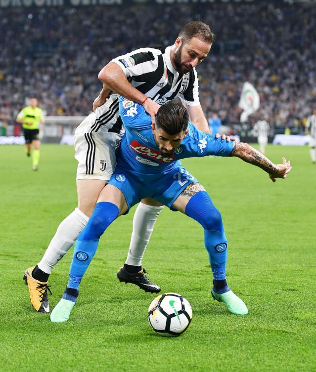 Juventus's Gonzalo Higuain, left, and Napoli's Elseid Hysaj during a Serie A soccer match between Juventus and Napoli at the Allianz Stadium in Turin, Italy, Sunday, April 22, 2018. (Alessandro Di Marco/ANSA via AP)