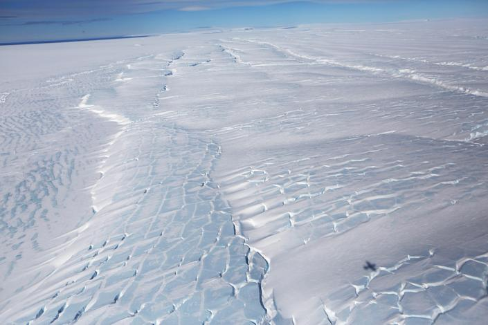 <p>Sections of blue ice are viewed from NASA's Operation IceBridge research aircraft, in the Antarctic Peninsula region on Oct. 31, 2017, above Antarctica. (Photo: Mario Tama/Getty Images) </p>