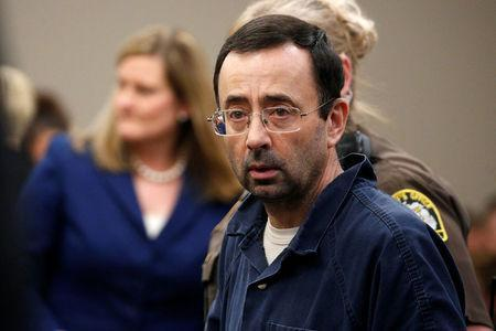Larry Nassar, a former team USA Gymnastics doctor who pleaded guilty in November 2017 to sexual assault charges, stands in the courtroom during his sentencing hearing in Lansing, Michigan, U.S., January 18, 2018. REUTERS/Brendan McDermid
