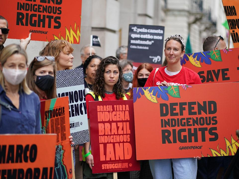 Demonstrators during a protest calling for an end to 'the genocidal attacks being waged against Brazil's indigenous peoples' at the Brazilian Embassy (PA)