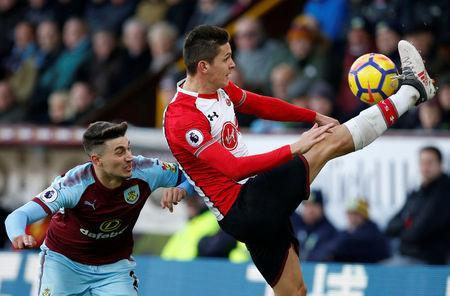 Soccer Football - Premier League - Burnley vs Southampton - Turf Moor, Burnley, Britain - February 24, 2018 Southampton's Guido Carrillo in action with Burnley's Matthew Lowton REUTERS/Andrew Yates