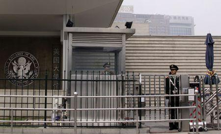 Paramilitary police officers guard the entrance to the U.S. embassy in Beijing
