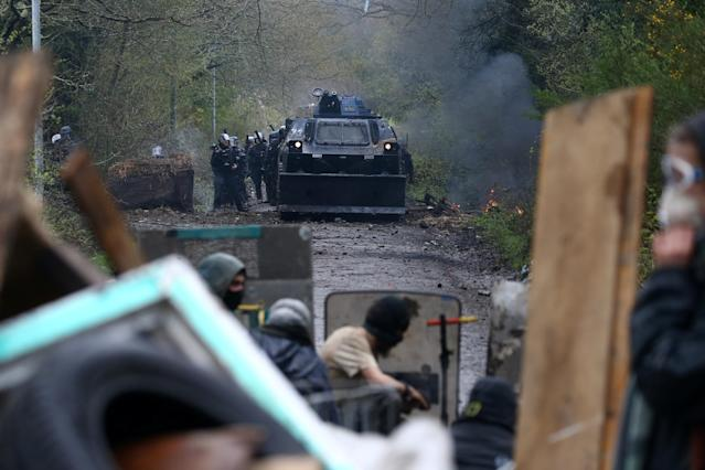 <p>Protesters gather on a road as French gendarmes advance with an armoured vehicle during clashes during an evacuation operation in the zoned ZAD (Deferred Development Zone) at Notre-Dame-des-Landes, near Nantes, France, April 10, 2018. (Photo: Stephane Mahe/Reuters) </p>