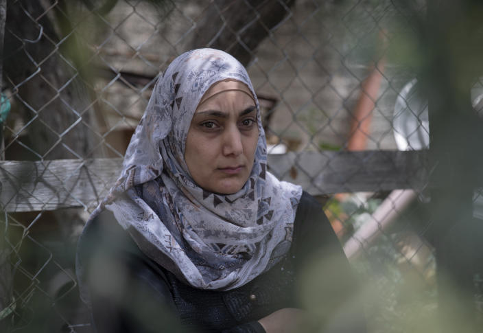 Somaya, the wife of Palestinian Osama Mansour, who was shot to death by Israeli soldiers at a temporary checkpoint in the occupied West Bank earlier this month, speaks to journalists at her family house, in the West Bank village of Biddu, west of Ramallah, Tuesday, April 20, 2021. Somaya, who was in the car with her husband and was wounded by the gunfire, says they followed the soldiers' instructions and posed no threat. The shooting death has revived criticism of the Israeli military's use of deadly force. (AP Photo/Nasser Nasser)