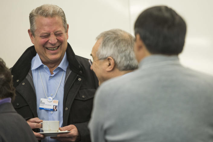 Al Gore, former Vice-President of the United States, laughs prior to a panel session during the opening day of the 44. Annual Meeting of the World Economic Forum, WEF, in Davos, Switzerland, Wednesday, Jan. 22, 2014. (AP Photo/Keystone,Jean-Christophe Bott)