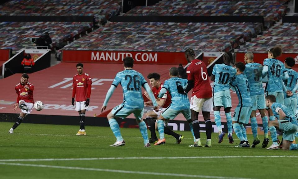 Bruno Fernandes sends a free-kick past the Liverpool wall to score Manchester United's winner