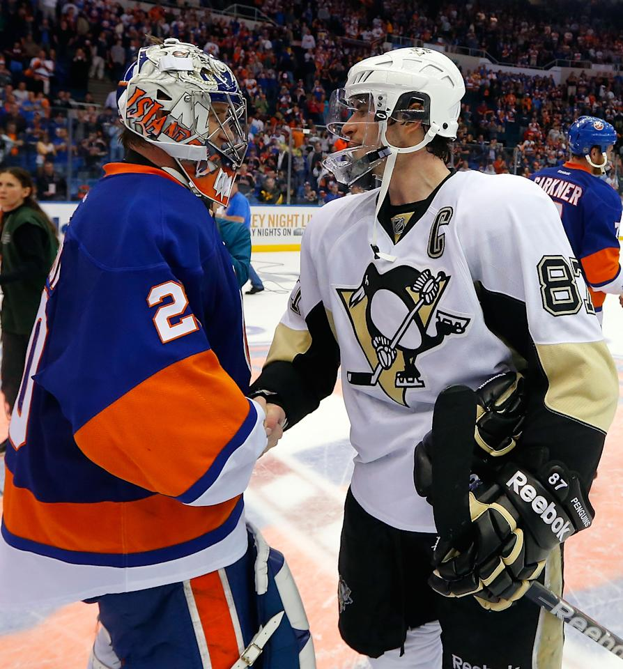 UNIONDALE, NY - MAY 11: Goalie Evgeni Nabokov #20 of the New York Islanders shakes hands with Sidney Crosby #87 of the Pittsburgh Penguins after the Islanders were eliminated from the playoffs in Game Six of the Eastern Conference Quarterfinals  during the 2013 NHL Stanley Cup Playoffs at Nassau Veterans Memorial Coliseum on May 11, 2013 in Uniondale, New York.  Penguins won 4-3 in overtime.  (Photo by Paul Bereswill/Getty Images)