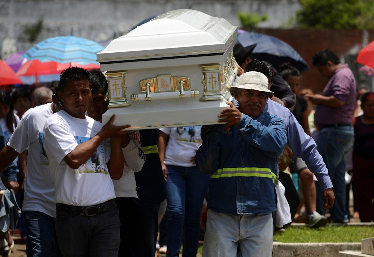 <p>Relatives and friends of Joel Rayon Paniagua, one of the victims of the shooting at the Pulse night club in Orlando, carry his coffin while arriving to a cemetery for his funeral in Cordoba, in Veracruz state, Mexico, June 24, 2016. (REUTERS/Oscar Martinez) </p>