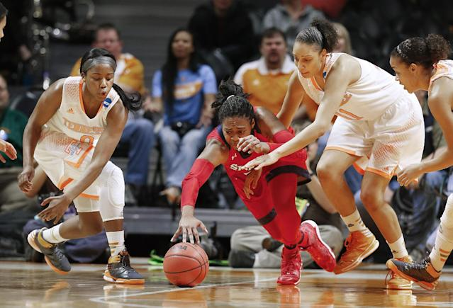 St. John's forward Amber Thompson, center, dives for a loose ball with Tennessee's Jordan Reynolds, left, Cierra Burdick (11), and Andraya Carter, right, in the first half of an NCAA women's college basketball second-round tournament game Monday, March 24, 2014, in Knoxville, Tenn. (AP Photo/John Bazemore)