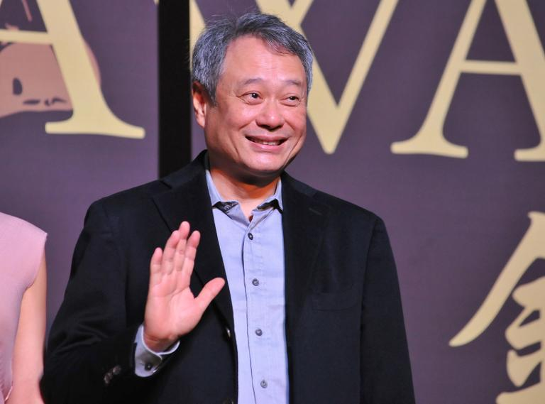 Oscar-winning director Ang Lee waves during a media event for the 50th Golden Horse awards in Taipei on November 12, 2013