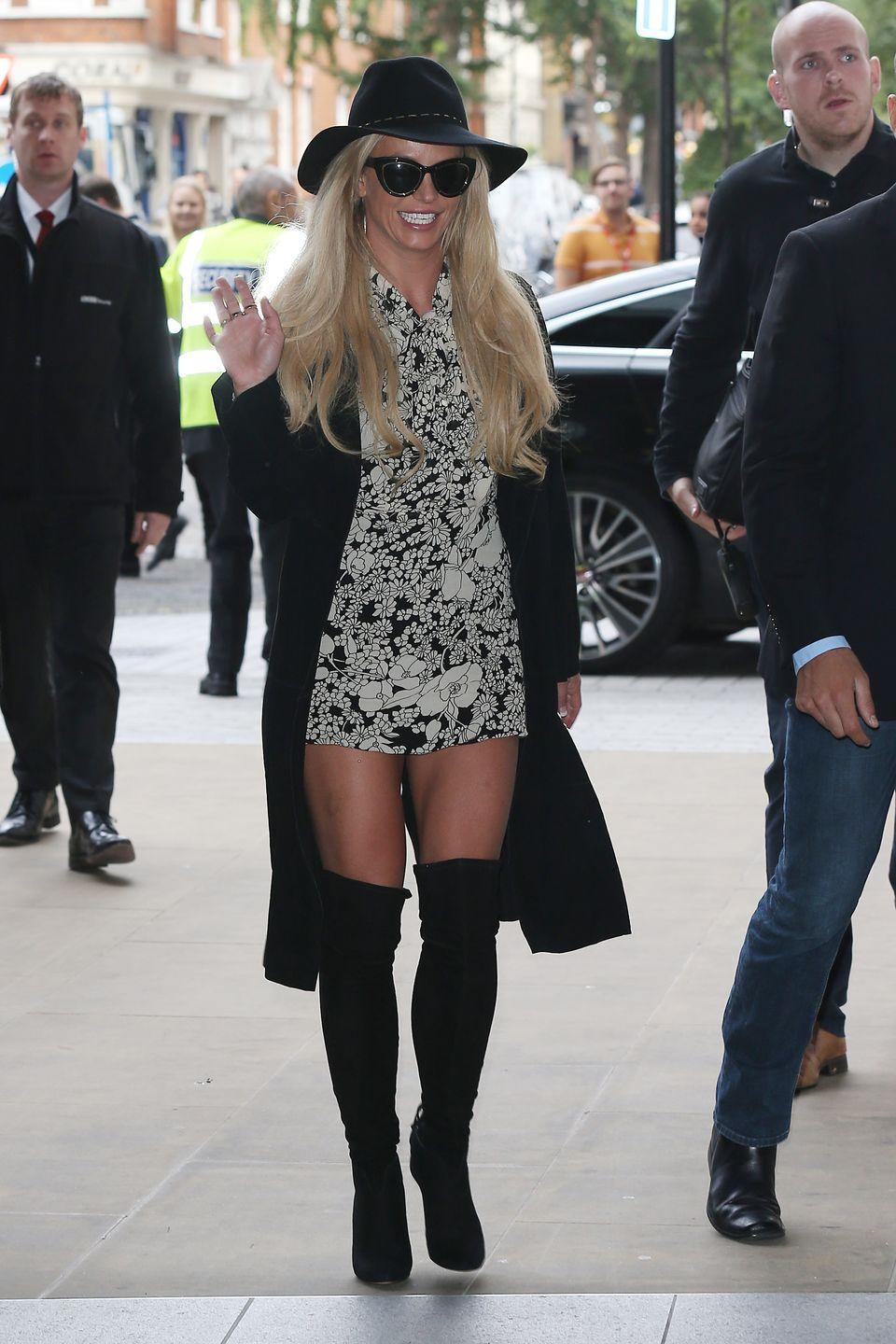 <p>I'll give it to her, Brit sure knows how to slay the accessories game. Matching her hat, sunglasses, jacket, and over-the-knee boots, she's bringing some chic AF vibes to her wardrobe. </p>