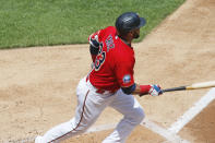 Minnesota Twins' Nelson Cruz watches his RBI single off Pittsburgh Pirates pitcher Joe Musgrove in the second inning of a baseball game, Tuesday, Aug. 4, 2020, in Minneapolis. (AP Photo/Jim Mone)