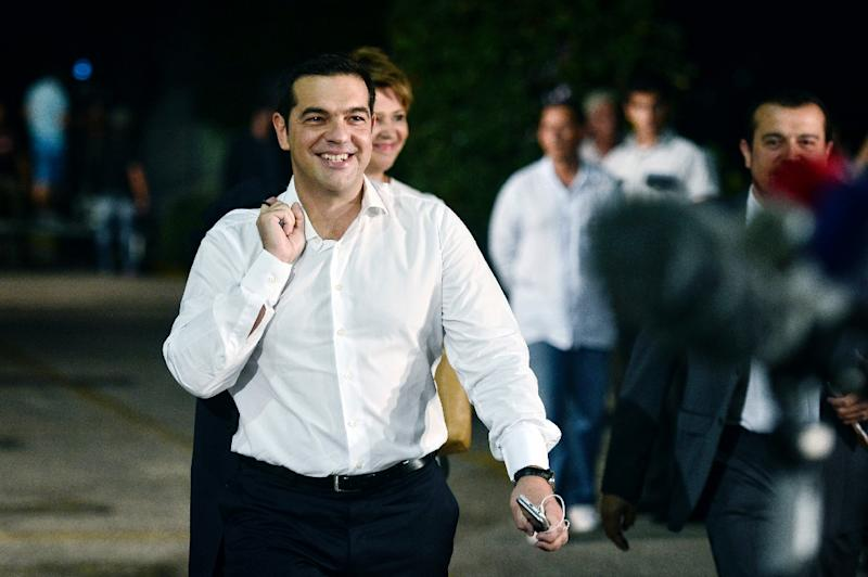 Former Greek Prime Minister Alexis Tsipras and leader of the left-wing Syriza party arrives for a live pre-election televised debate at the state-run ERT television in Athens, on September 14, 2015 (AFP Photo/Louisa Gouliamaki)