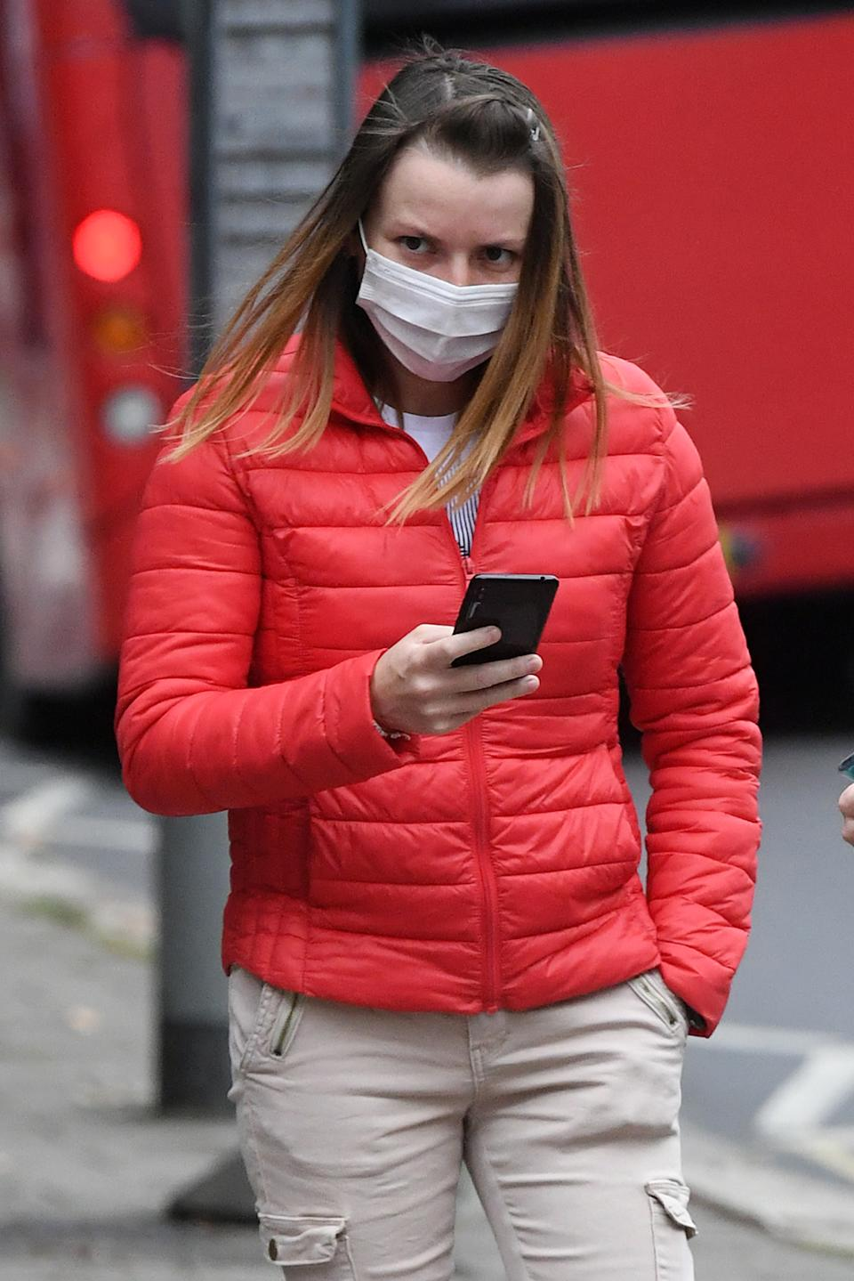 Aurora Iacomi, 31, arrives at Inner London Crown Court for sentencing after she admitted putting cleaning fluid into her supervisor's coffee flask at Fenchurch Street railway station on April 22.