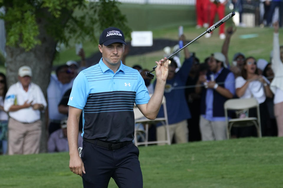 Jordan Spieth reacts after making an eagle putt on the 18th green during the first round of the AT&T Byron Nelson golf tournament, Thursday, May 13, 2021, in McKinney, Texas. (AP Photo/Tony Gutierrez)