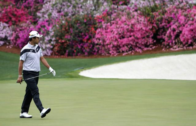Hideki Matsuyama of Japan walks on the 13th green during the final day of practice for the 2018 Masters golf tournament at Augusta National Golf Club in Augusta, Georgia, U.S. April 4, 2018. REUTERS/Jonathan Ernst