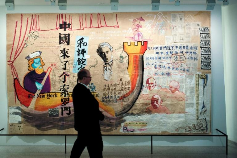 "A man walks past Zhou Tiehai's ""There Came a Mr Solomon to China"" (1994)"