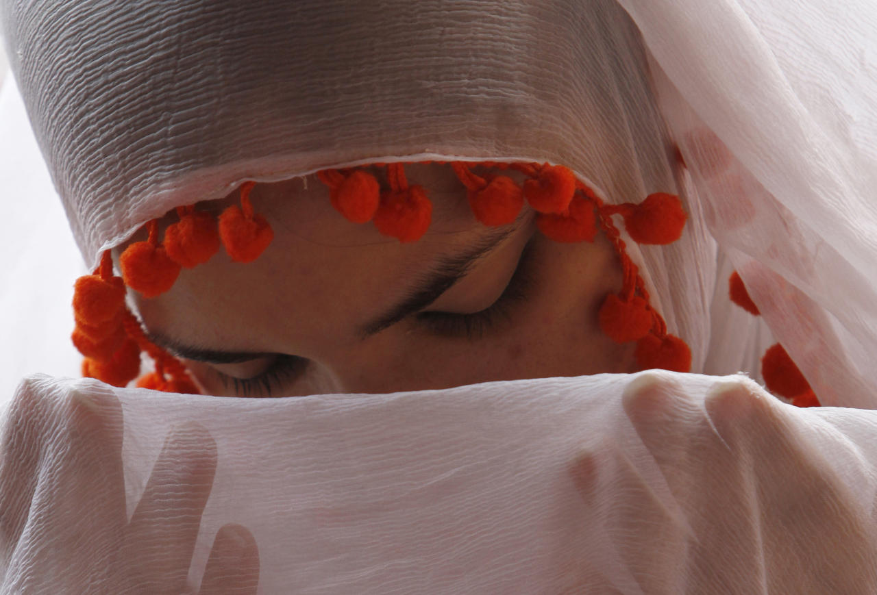 A Pakistani girl prays at a Friday congregation at a local mosque on the last Friday of the Muslim fasting month of Ramadan in Lahore, Pakistan on Aug 26, 2011. (AP Photo/K.M.Chaudary)