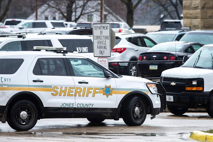 A Jones County Sheriff's vehicle parks outside the Anamosa State Penitentiary, Tuesday, March 23, 2021, in Anamosa, Iowa.