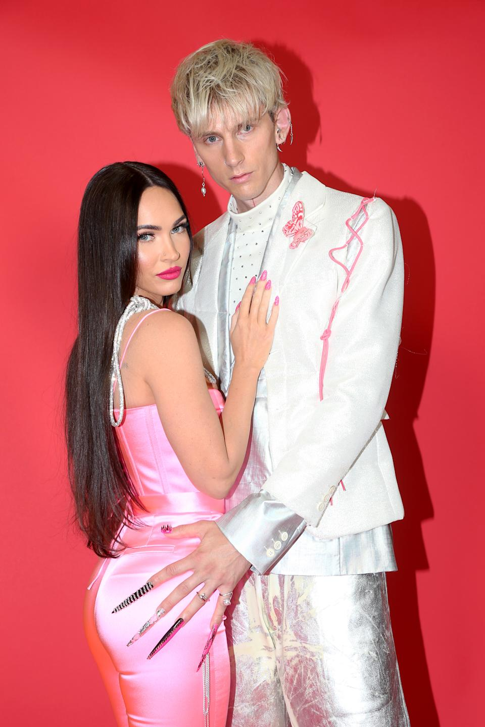 LOS ANGELES, CALIFORNIA - MAY 27: (EDITORIAL USE ONLY) (L-R) Megan Fox and Machine Gun Kelly attend the 2021 iHeartRadio Music Awards at The Dolby Theatre in Los Angeles, California, which was broadcast live on FOX on May 27, 2021. (Photo by Phillip Faraone/Getty Images for iHeartMedia)