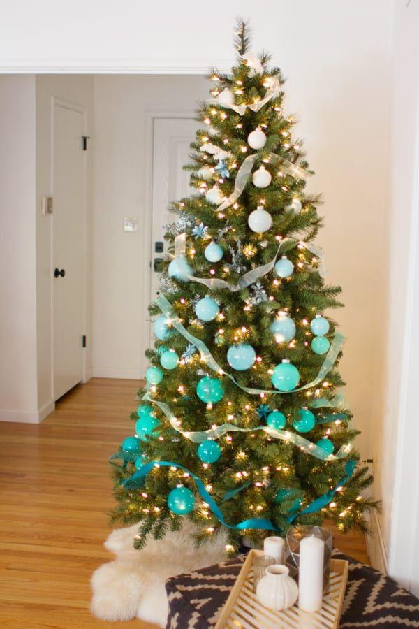 """<p>DIY or buy ornaments in varying shades of blue (or any color, really!) to create a gorgeous gradient. </p><p><em><a href=""""https://lovelyindeed.com/diy-ombre-christmas-tree/"""" rel=""""nofollow noopener"""" target=""""_blank"""" data-ylk=""""slk:Get the tutorial at Lovely Indeed »"""" class=""""link rapid-noclick-resp"""">Get the tutorial at Lovely Indeed »</a></em></p>"""