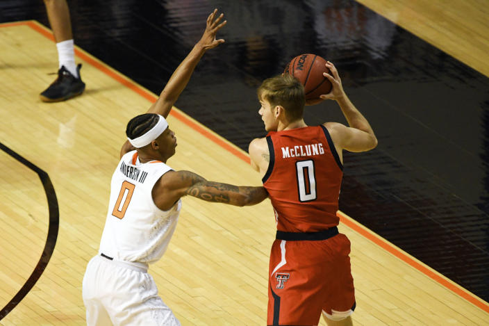 Oklahoma State guard Avery Anderson III (0) guards against Texas Tech guard Mac McClung (0) during an NCAA college basketball game Monday, Feb. 22, 2021, in Stillwater, Okla. (AP Photo/Brody Schmidt)