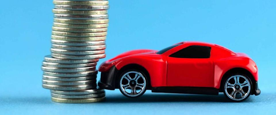 toy car crashed into coins