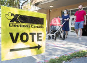 <p>People leave a polling station after voting on federal election day in Montreal, Monday, Sept. 20, 2021. THE CANADIAN PRESS/Graham Hughes</p>