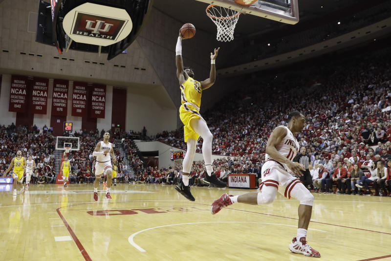 Minnesota's Daniel Oturu (25) goes up for a dunk against Indiana's Devonte Green (11) during the first half of an NCAA college basketball game, Wednesday, March 4, 2020, in Bloomington, Ind. Indiana defeated Minnesota 72-67. (AP Photo/Darron Cummings)