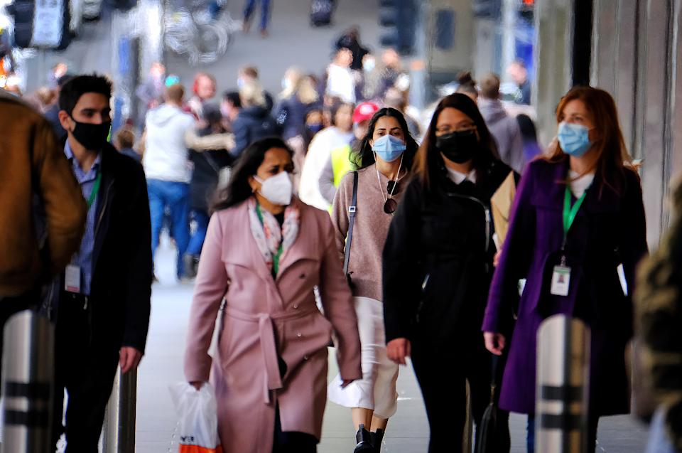People wearing face masks walk in the Melbourne CBD. Source: AAP
