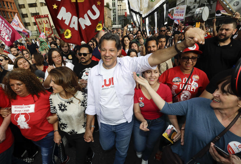 Fernando Haddad, presidential candidate for the Workers Party, greets supporters during a campaign rally in Sao Paulo, Brazil, Sunday, Sept. 16, 2018. Brazil will hold general elections on Oct. 7. (AP Photo/Andre Penner)