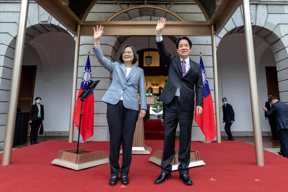 In this photo released by the Taiwan Presidential Office, Taiwanese President Tsai Ing-wen, center left, waves with Vice President Lai Ching-te after their inauguration ceremony and arriving at a government guest house in Taipei, Taiwan on Wednesday, May 20, 2020. Tsai has been inaugurated for a second term amid increasing pressure from China on the self-governing island democracy it claims as its own territory. (Taiwan Presidential Office via AP)