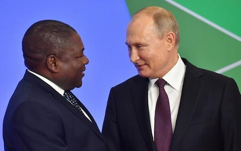 Vladimir Putin greets the president of Mozambique in Sochi last week - Credit: Kirill Kukhmar/TASS via Getty