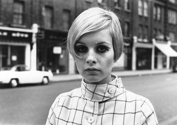 <p>British fashion model Twiggy became known for her pixie cut in the late '60s. Here, the model adds a daring curl to frame her eyes for the ultimate mod look. </p>