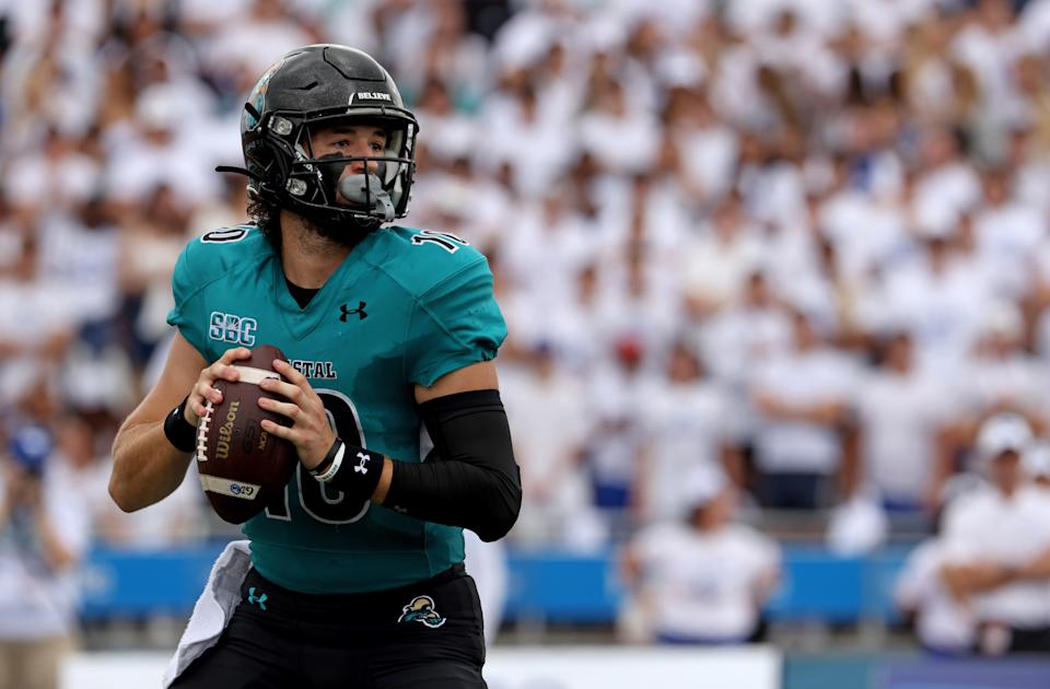 BUFFALO, NY - SEPTEMBER 18: Grayson McCall #10 of the Coastal Carolina Chanticleers drops back to throw a pass against the Buffalo Bulls at UB Stadium on September 18, 2021 in Buffalo, New York. (Photo by Timothy T Ludwig/Getty Images)