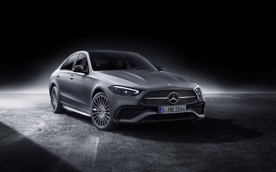 """<p>Mercedes-Benz has just revealed its all-new 2022 C-Class. It gets hybrid tech as standard and looks from the bigger E- and S-Class sedans. There's a modern interior with a massive central touchscreen, and even a fingerprint sensor. Check out the full story:<br><br><a class=""""link rapid-noclick-resp"""" href=""""https://www.roadandtrack.com/news/a35584865/2022-mercedes-benz-c-class-revealed/"""" rel=""""nofollow noopener"""" target=""""_blank"""" data-ylk=""""slk:Read More"""">Read More</a></p>"""