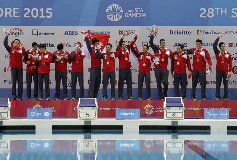 28th SEA Games Singapore 2015 - OCBC Aquatic Centre, Singapore - 16/6/15 Water Polo - Men's Round Robin - Singapore v Indonesia - The Singapore team celebrates winning the gold medal TEAMSINGAPORE Mandatory Credit: Singapore SEA Games Organising Committee / Action Images via Reuters