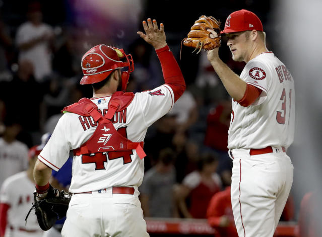 Los Angeles Angels catcher Joe Hudson and pitcher Ty Buttrey celebrate after their 1-0 win over the Texas Rangers after a baseball game in Anaheim, Calif., Tuesday, Sept. 11, 2018. (AP Photo/Chris Carlson)