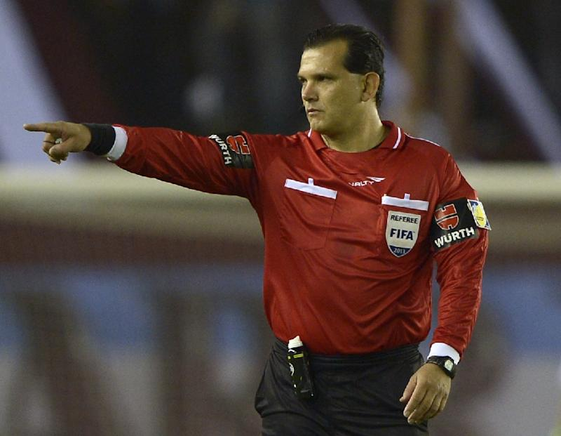 Paraguayan referee Carlos Amarilla officiates a game in Lanus, Buenos Aires, Argentina, on September 18, 2013