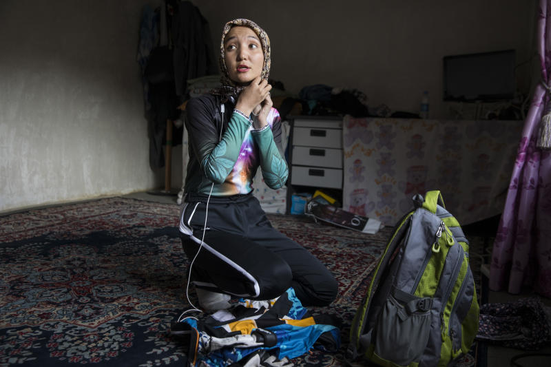 Photographer Paula Bronstein captured 23-year-old Zakia getting ready for a bike ride. It's frowned upon for women in Afghanistan to ride bicycles, but Zakia defies those stereotypes. (Paula Bronstein)