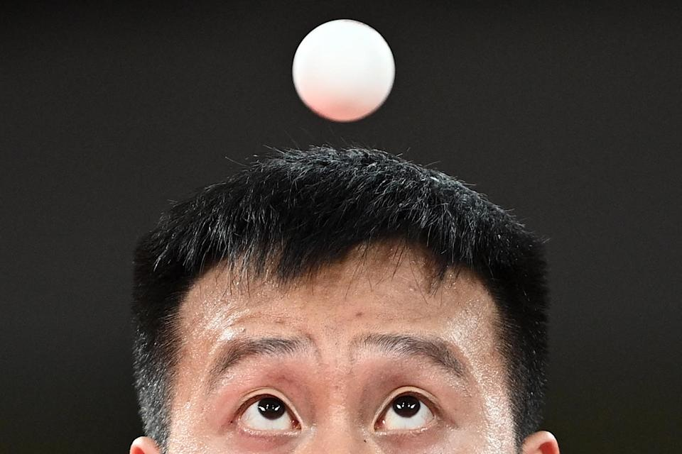<p>Slovakia's Yang Wang competes against Australia's Dave Powell (not pictured) in the July 26 men's singles round two table tennis match.</p>