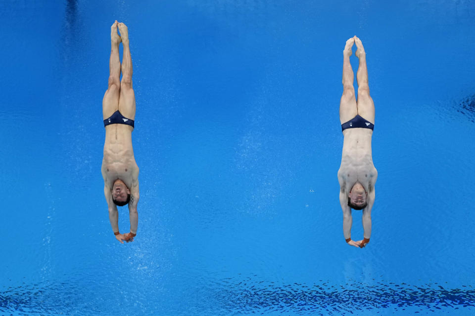 """FILE - In this July 26, 2021, file photo, gold medal winners Britain's Thomas Daley and Matty Lee compete in the synchronized 10-meter platform diving final at the 2020 Summer Olympics, in Tokyo. The Tokyo Games are shaping up as a watershed for LGBTQ Olympians. Daley announced in 2013 that he was dating a man and """"couldn't be happier,"""" his coming out was an act of courage that, with its rarity, also exposed how the top echelons of sport weren't seen as a safe space by the vast majority of LGBTQ athletes. (AP Photo/David J. Phillip, File)"""