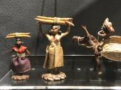 In this Nov. 24, 2019 photo, latex figures made in the 1940s depicting daily life in Jamaica in the sugar cane fields displayed at the International Slavery Museum in Liverpool, England. The museum seeks to tell the story of the enslavement of people from Africa and how the British city benefited from human bondage. (AP Photo/Russell Contreras)