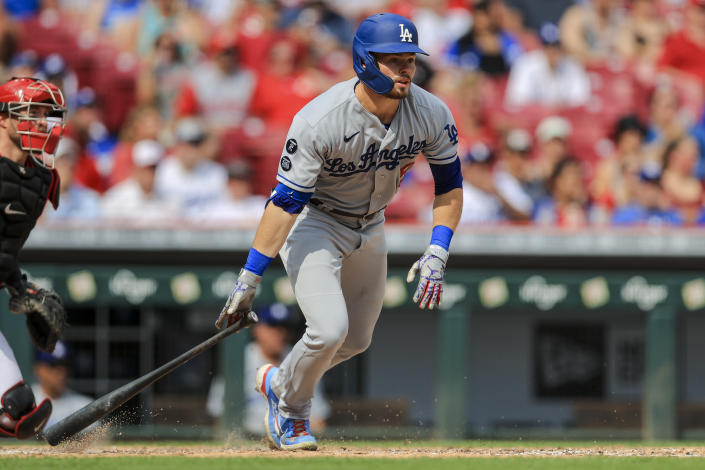 Los Angeles Dodgers' Gavin Lux watches as he hits a two-run triple during the fifth inning of a baseball game against the Cincinnati Reds in Cincinnati, Saturday, Sept. 18, 2021. (AP Photo/Aaron Doster)