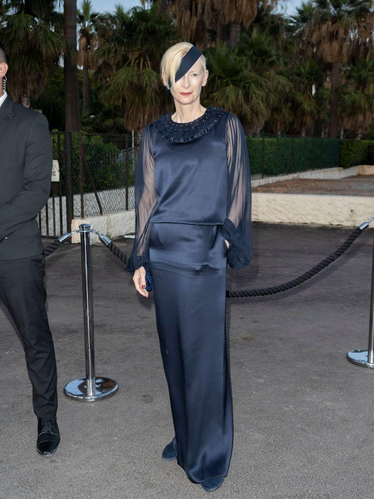 <p>The Brit wore navy Chanel to the brand's dinner. </p>